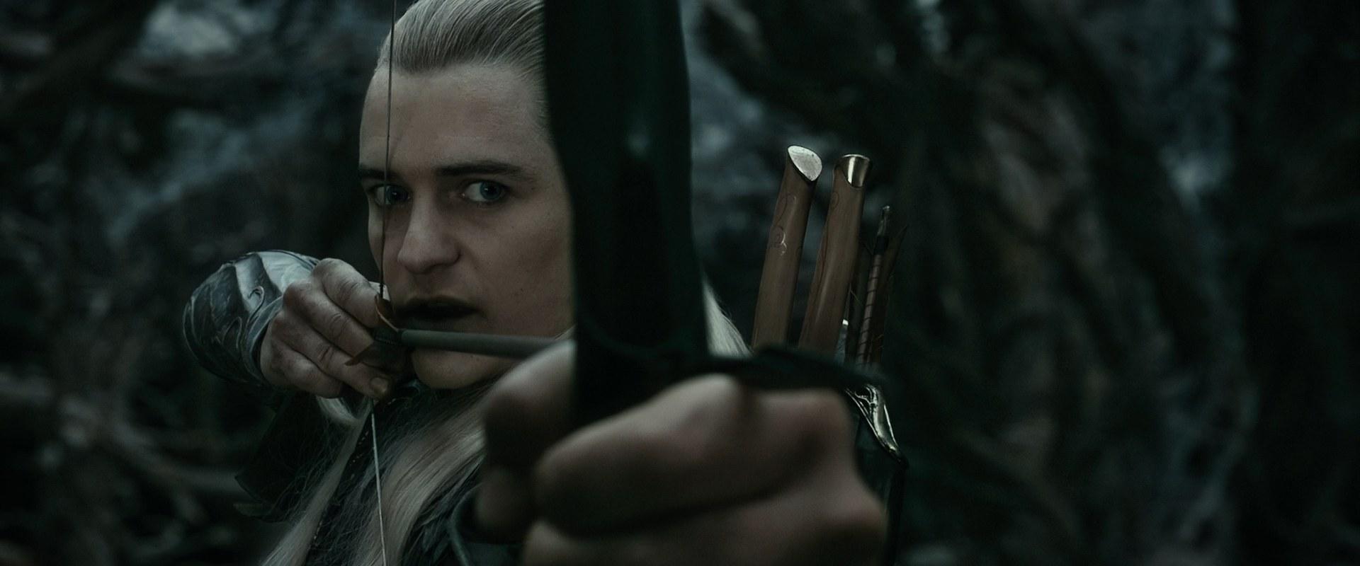 Orlando Bloom som Legolas, skjuter pilbåge