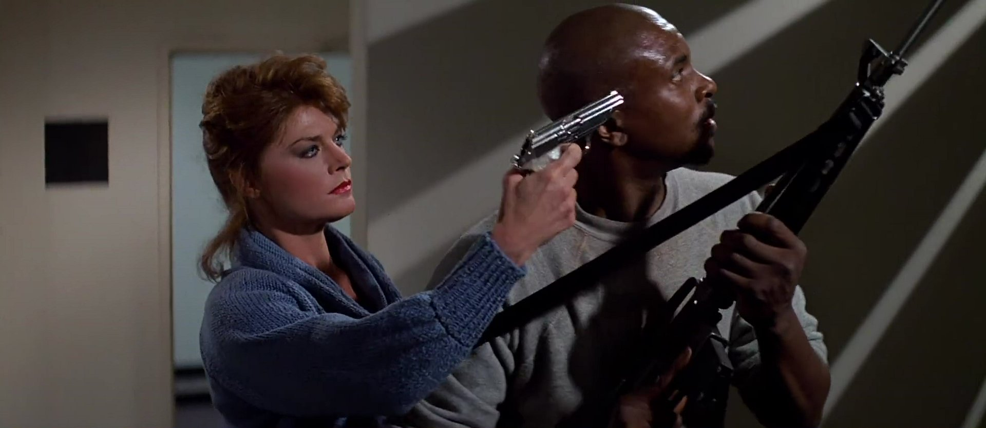 Keith David  with Meg Foster  in  They Live  Keith David They Live
